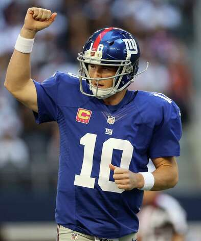 ARLINGTON, TX - OCTOBER 28:  Eli Manning #10 of the New York Giants celebrates a touchdown by  Henry Hynoski #45 against the Dallas Cowboys at Cowboys Stadium on October 28, 2012 in Arlington, Texas. Photo: Ronald Martinez, Getty Images / 2012 Getty Images