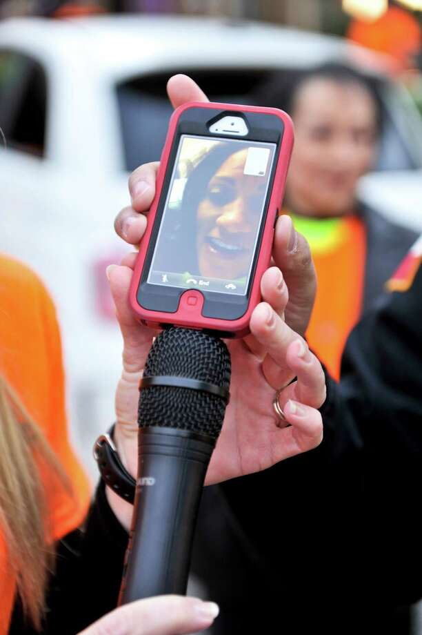 Monica Caban speaks via Skype to the over 300 bicycle riders gathered for a ride in her honor on Oct. 28, 2012, at the Shrine Auditorium. Caban was seriously injured by an automobile while on her cycle training for a triathalon. Photo: Robin Jerstad/For The Express-Ne