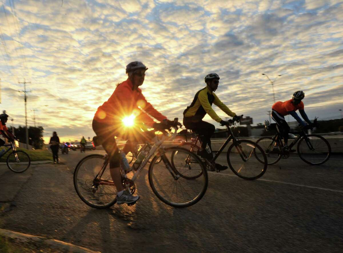 Bicyclists move along a Loop 1604 access road. Readers weigh in on bicyclists sharing the road with vehicles.