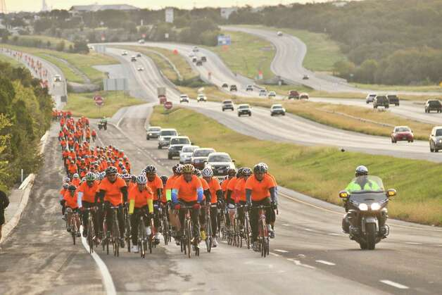 More than 300 bicyclists move along the I-10 access road during a ride on Oct. 28, 2012,  to benefit Monica Caban. Caban was struck and severely injured by a car while training on her bike for a triathalon. Photo: File Photo, San Antonio Express-News