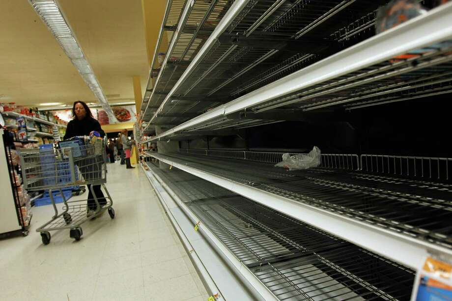 Only a few bread items remain on shelves at a Long Beach, New York grocery store as Hurricane Sandy approaches the region. Photo: Mike Stobe, Getty Images / Getty Images North America