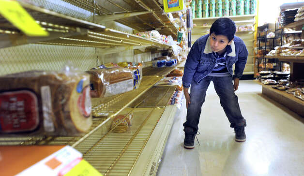 """It's all gone,"" says John Chabla, 10, of Danbury, who was looking for bread while shopping with his family at C-Town in Danbury Sunday, Oct. 28, 2012. Many Danbury area residents spent the day Sunday preparing for Hurricane Sandy. Photo: Carol Kaliff"