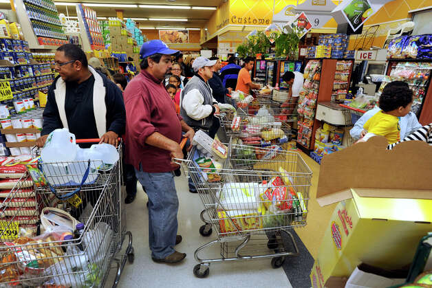 Shoppers crowded the aisles at C-Town in Danbury, stocking up on essentials such as water and bread, Sunday, Oct. 28, 2012.  Many Danbury area residents spent the day preparing for Hurricane Sandy. Photo: Carol Kaliff