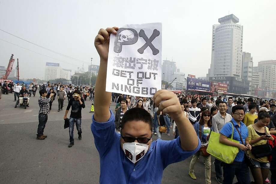 Protesters march in Ningbo, China, against the expansion of a petrochemical plant, one of nearly 500 public demonstrations staged in the country each day. Photo: Ng Han Guan, Associated Press