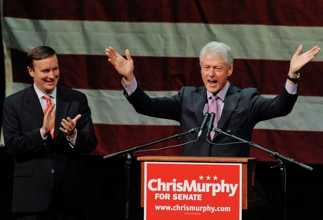 Former President Bill Clinton, right, gestures while speaking at a rally for Democratic candidate for U.S. Senate Chris Murphy, left, at a rally in Waterbury, Conn., Sunday, Oct. 28, 2012. Murphy and Republican opponent Linda McMahon are vying for the Senate seat now held by Joe Lieberman, an independent who's retiring. (AP Photo/Jessica Hill) Photo: Jessica Hill, Associated Press / FR125654 AP