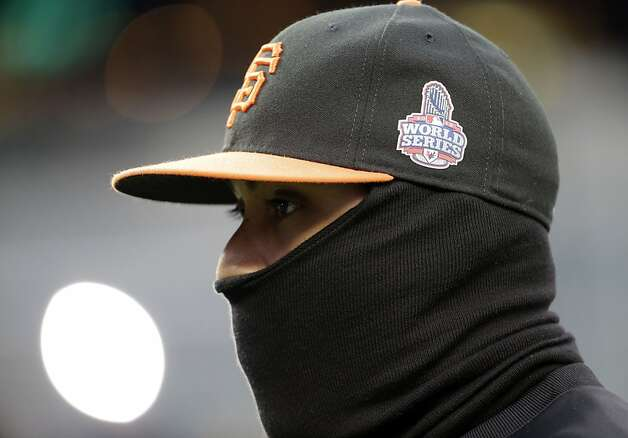 San Francisco Giants' Hector Sanchez is bundled up during batting practice before Game 4 of baseball's World Series against the Detroit Tigers Sunday, Oct. 28, 2012, in Detroit. (AP Photo/David J. Phillip) Photo: David J. Phillip, Associated Press
