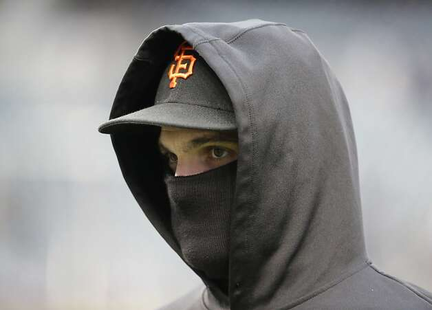 San Francisco Giants' Ryan Theriot is bundled up during batting practice before Game 4 of baseball's World Series against the Detroit Tigers Sunday, Oct. 28, 2012, in Detroit. (AP Photo/David J. Phillip) Photo: David J. Phillip, Associated Press