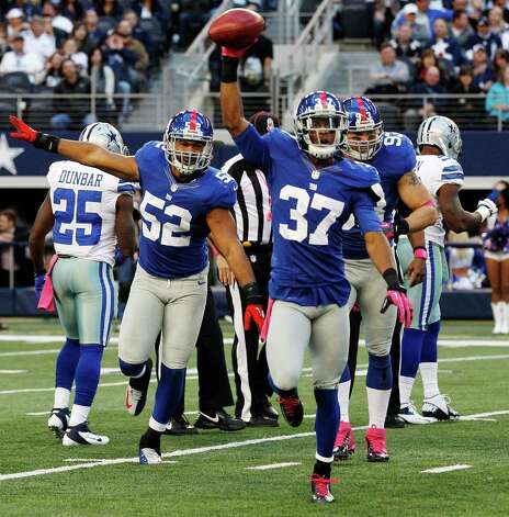 New York Giants cornerback Michael Coe (37) celebrates his fumble recovery against the Dallas Cowboys during the first half of an NFL football game Sunday, Oct. 28, 2012 in Arlington, Texas. (AP Photo/Tony Gutierrez) Photo: Tony Gutierrez, Associated Press / AP