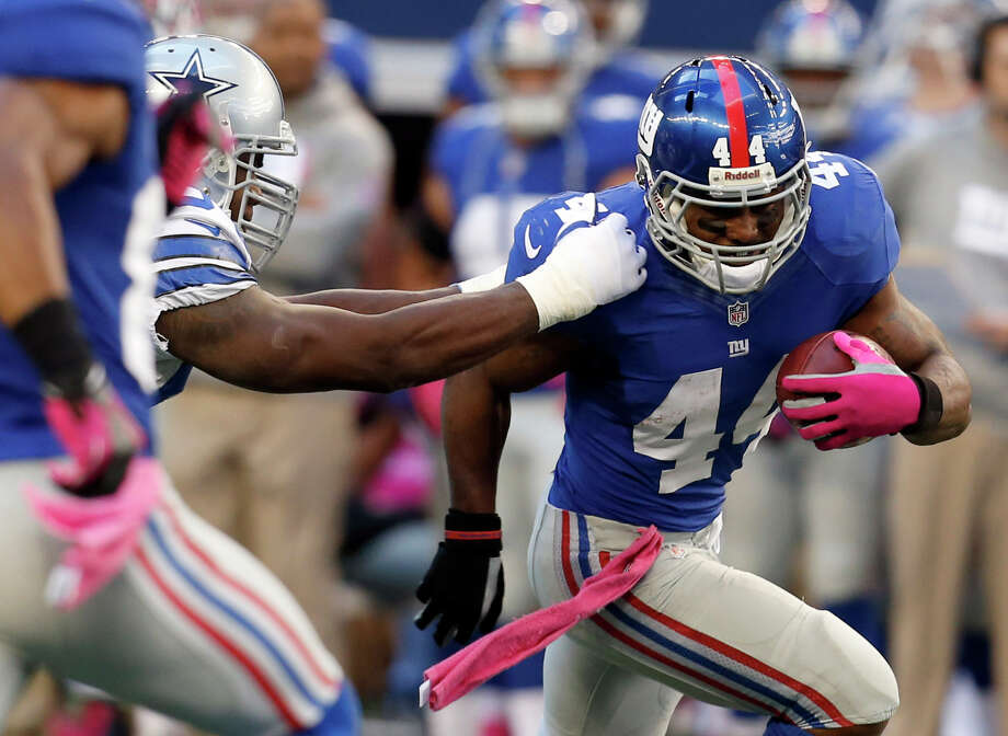 New York Giants running back Ahmad Bradshaw (44) gets past Dallas Cowboys outside linebacker DeMarcus Ware during the first half of an NFL football game Sunday, Oct. 28, 2012 in Arlington, Texas. (AP Photo/Sharon Ellman) Photo: Sharon Ellman, Associated Press / FR170032 AP