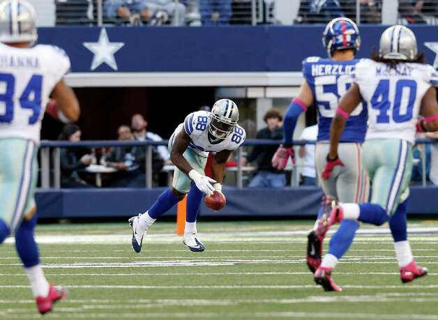Dallas Cowboys wide receiver Dez Bryant (88) picks up, then fumbles a punt against the New York Giants during the first half of an NFL football game Sunday, Oct. 28, 2012 in Arlington, Texas. (AP Photo/Sharon Ellman) Photo: Sharon Ellman, Associated Press / FR170032 AP
