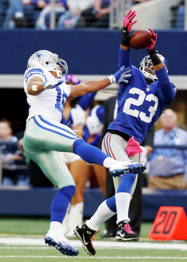 New York Giants cornerback Corey Webster (23) intercepts a pass from Dallas Cowboys quarterback Tony Romo intended for wide receiver Miles Austin (19) during the first half of an NFL football game Sunday, Oct. 28, 2012 in Arlington, Texas. (AP Photo/Sharon Ellman) Photo: Sharon Ellman, Associated Press / FR170032 AP