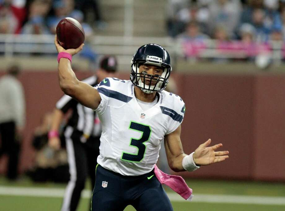 Seattle Seahawks quarterback Russell Wilson (3) throws a pass against the Detroit Lions in the first half of an NFL football game, Sunday, Oct. 28, 2012. in Detroit. Photo: AP