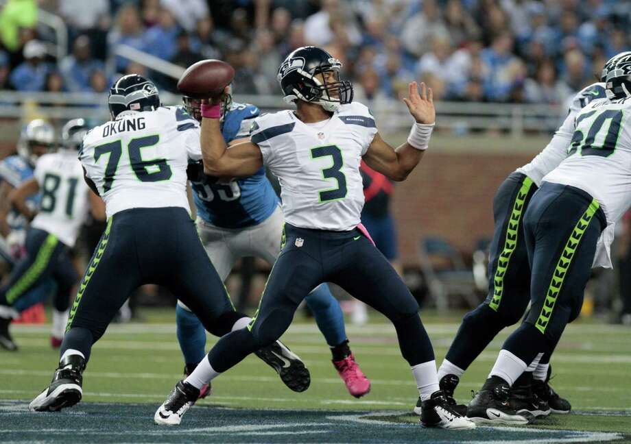 Seattle Seahawks quarterback Russell Wilson (3) throws a pass in the first half of an NFL football game against the Detroit Lions, Sunday, Oct. 28, 2012. in Detroit. Photo: AP