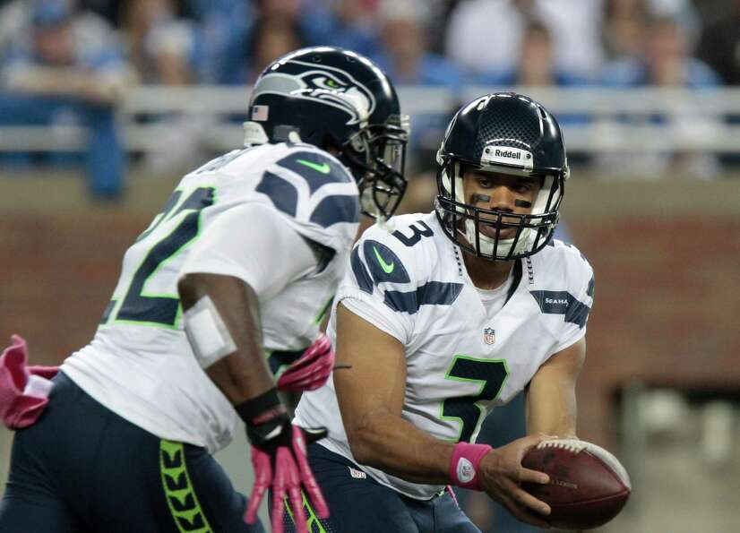 Seattle Seahawks quarterback Russell Wilson (3) hands off the ball to running back Robert Turbin (22