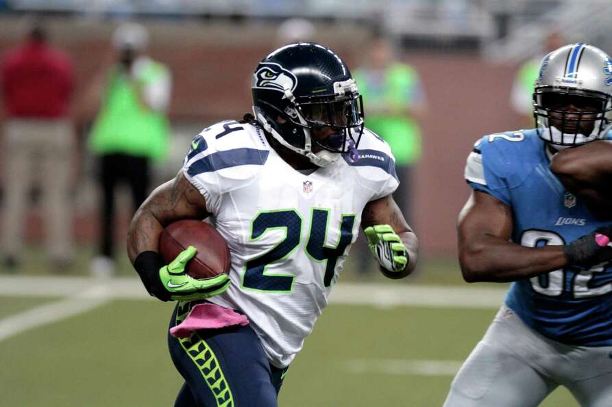 Seattle Seahawks running back Marshawn Lynch (24) rushes against the Detroit Lions in the first half