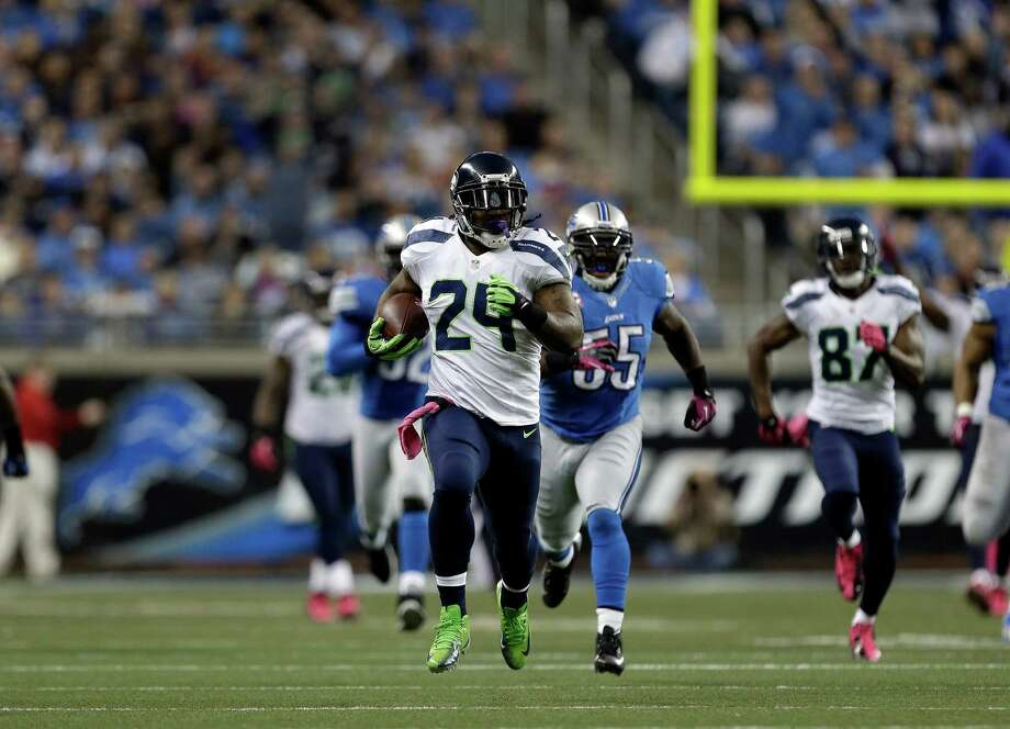 Seattle Seahawks running back Marshawn Lynch (24) scores on a  77 yard touchdown run against the Detroit Lions in the first half of an NFL football game, Sunday, Oct. 28, 2012. in Detroit. Photo: AP