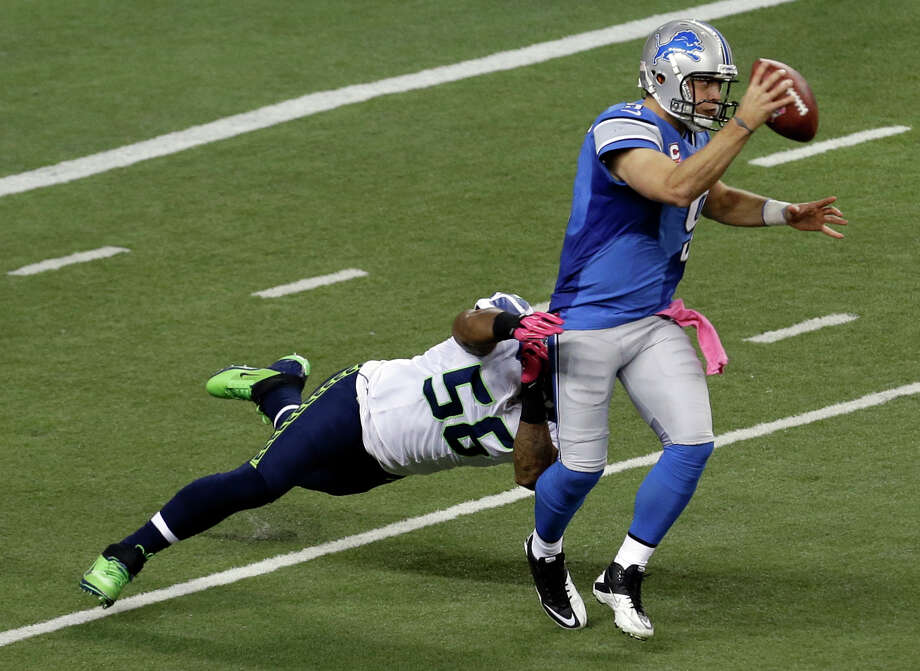 Seattle Seahawks outside linebacker Leroy Hill (56) sacks Detroit Lions quarterback Matthew Stafford (9) in the second half of an NFL football game, Sunday, Oct. 28, 2012. in Detroit. Photo: AP