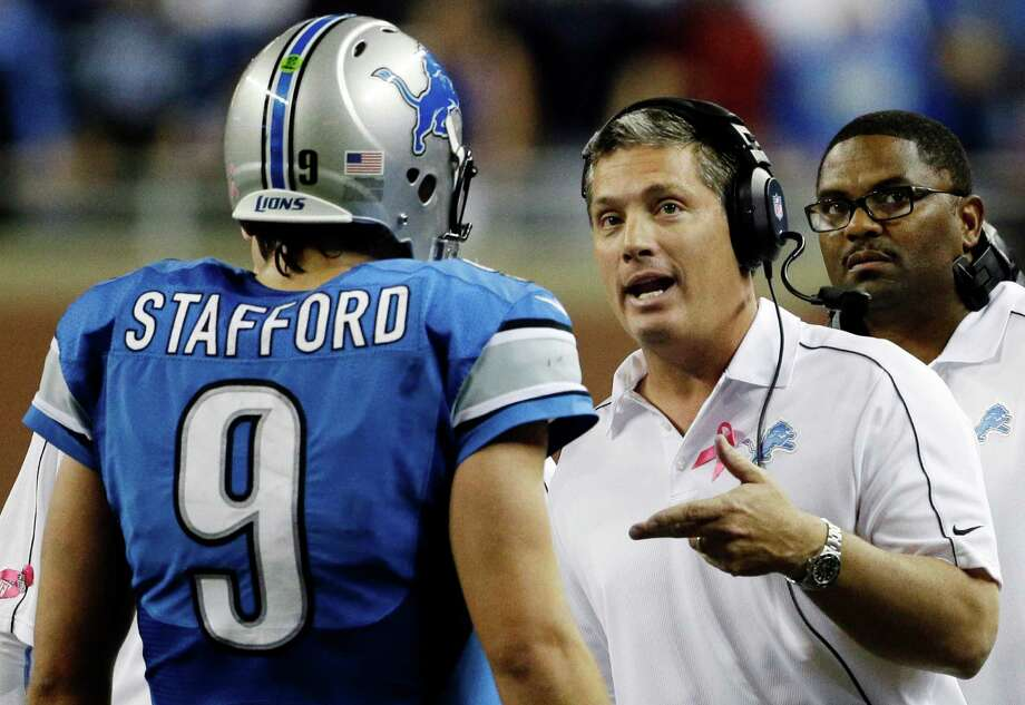 Detroit Lions head coach Jim Schwartz talks to quarterback Matthew Stafford (9) in the second half of an NFL football game against the Seattle Seahawks, Sunday, Oct. 28, 2012. in Detroit. The Lions won 28-24. Photo: AP