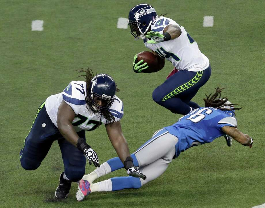 Seattle Seahawks running back Marshawn Lynch (24) leaps over Detroit Lions free safety Louis Delmas (26) in the second half of an NFL football game, Sunday, Oct. 28, 2012. in Detroit. At left is Seattle Seahawks guard James Carpenter (77). Photo: AP