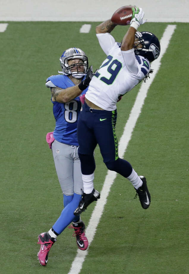 Seattle Seahawks free safety Earl Thomas (29) makes a catch against Detroit Lions tight end Tony Scheffler (85) in the second half of an NFL football game, Sunday, Oct. 28, 2012. in Detroit. Photo: AP