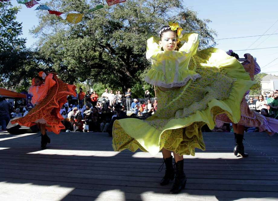 MECA Ballet Folklorico member Alyssa Salazar, 11, front right, and other members perform during the Día de los Muertos Festival at MECA, 1900 Kane Street, Sunday, Oct. 28, 2012, in Houston. The two-day Día de los Muertos Festival is a public celebration of community folk art traditions that commemorate family and community ancestors. Festival events included community altar exhibits, foods from Latin American countries, vendors selling Day of the Dead arts and crafts, and live performances of music and dance. Photo: Melissa Phillip, Houston Chronicle / Houston Chronicle