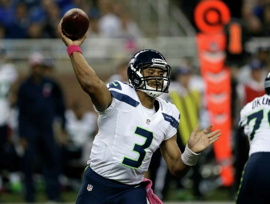 Seattle Seahawks quarterback Russell Wilson (3) thjrows a pass in the first half of an NFL football game against the Detroit Lions, Sunday, Oct. 28, 2012. in Detroit. Photo: AP