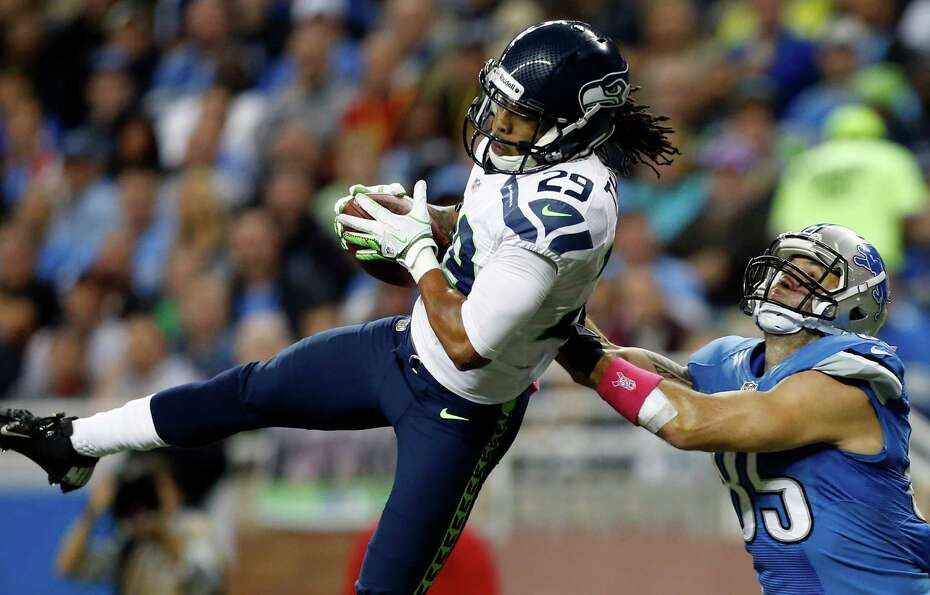 Seattle Seahawks free safety Earl Thomas (29) intercepts a pass intended for Detroit Lions tight end
