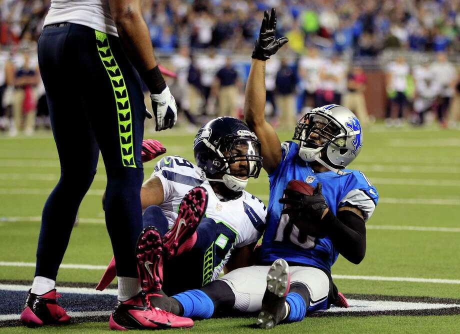Detroit Lions wide receiver Titus Young (16) celebrates his winning touchdown reception against Seattle Seahawks cornerback Brandon Browner (39) in the end zone during the second half of an NFL football game, Sunday, Oct. 28, 2012. in Detroit. The Lions won 28-24. Photo: AP