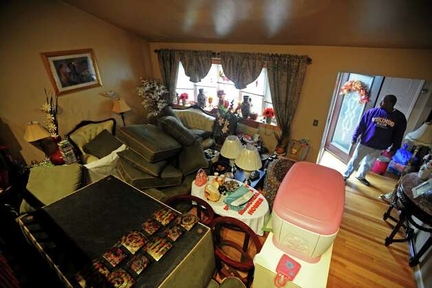103687 NEW MILFORD GEORGIEV 28102012 Chris Crawley at his house on Columbia ave in New Milford, with all his furniture stacked up at higher floor of as Hurricane Sandy approaches NJ, on Sunday, October 28. Him and his wife (not in the photo) are also leaving their house that got flooded during Hurricane Irene last year. (Chris can be reached on 9736529531.) MARKO GEORGIEV/STAFF PHOTOGRAPHER Photo: Marko Georgiev, MARKO GEORGIEV/STAFF PHOTOGRAPHE / © 2012 North Jersey Media Group