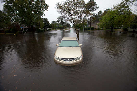 High water from Hurricane Sandy surrounds a car along Hampton Boulevard in Norfolk, Va., near Larchmont Crescent, Sunday morning, Oct. 28, 2012. Photo: Bill Tiernan, AP / The Virginian-Pilot