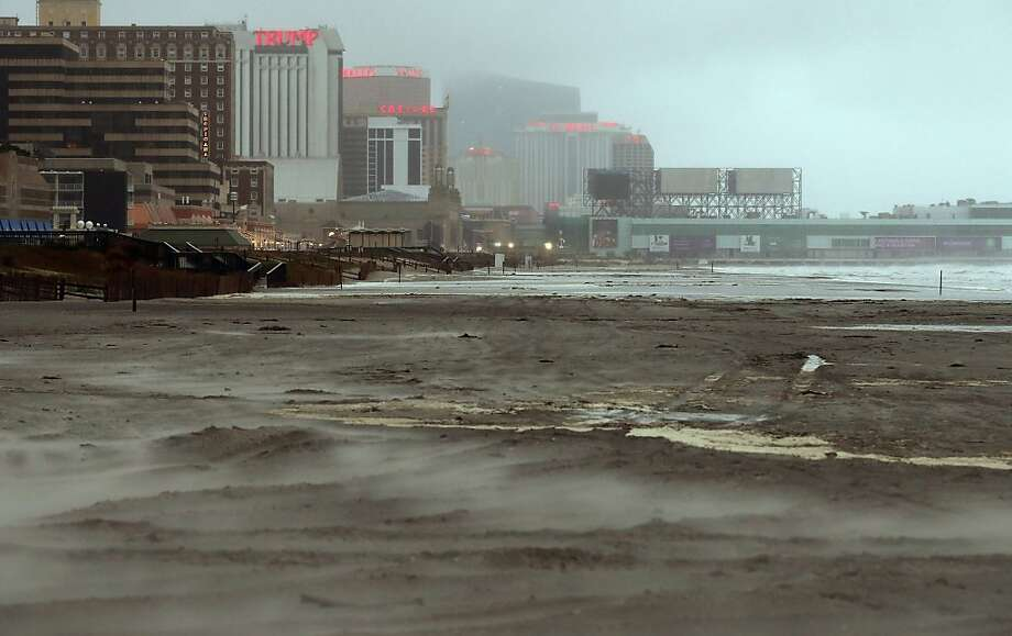 Sand blows across a beach in Atlantic City, N.J., where all 12 casinos were forced to close. Photo: Mario Tama, Getty Images