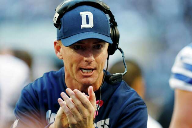 Dallas Cowboys head coach Jason Garrett applauds his team against the New York Giants during the first half of an NFL football game, Sunday, Oct. 28, 2012, in Arlington, Texas. (AP Photo/Sharon Ellman) Photo: Sharon Ellman, Associated Press / FR170032 AP