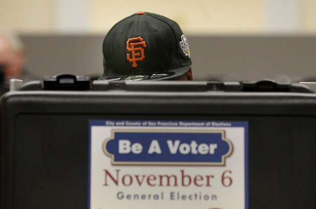 A Giants fan cast his early ballot. Early voting in San Francisco, Calif. began this weekend at City Hall.  One observer said they had about 400 voters on Saturday. Photo: Brant Ward, The Chronicle