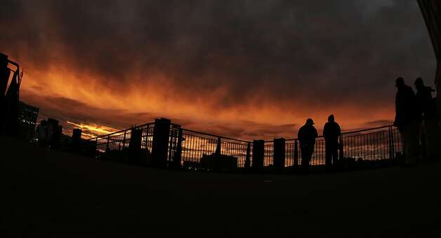 Fans wait for the start of Game 4 of baseball's World Series between the San Francisco Giants and the Detroit Tigers as the sun sets Sunday, Oct. 28, 2012, in Detroit. (AP Photo/Charlie Riedel) Photo: Charlie Riedel, Associated Press