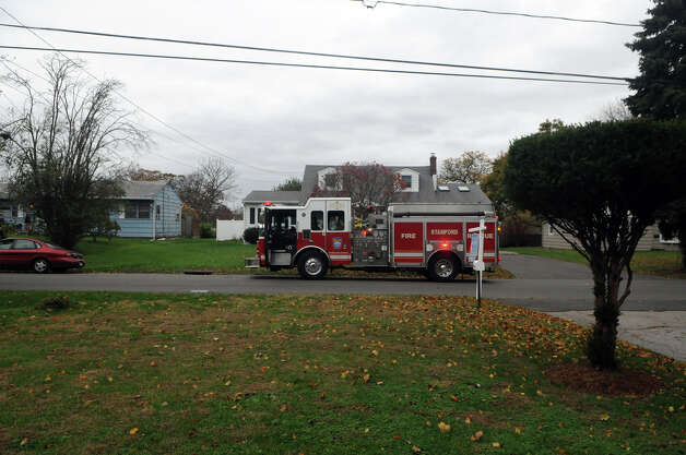 Stamford Fire and Rescue firefighters make their way around the Tupper Drive neighborhood as they let residents know about a mandatory evacuation as the city prepares for Hurricane Sandy in Stamford, Conn., October 28, 2012.  Mayor Michael Pavia declared a state of emergency and ordered residents of the much of the shoreline to evacuate their homes and seek higher ground. Photo: Keelin Daly