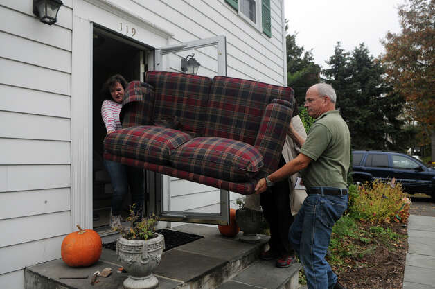 Bill Malloy and his daughter Suzanne Valeski remove a couch from his house as they prepare for Hurricane Sandy in Stamford, Conn., October 28, 2012. Malloy lives on Ralsey Road which was on the city's evacuation list. Mayor Michael Pavia declared a state of emergency and ordered residents of the much of the shoreline to evacuate their homes and seek higher ground. Photo: Keelin Daly