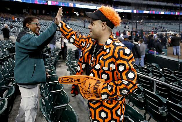 Tigers fan, Cheryl Gilliam admires Jamie Awad's of San Francisco outfit as the San Francisco Giants prepare to take on the Detroit Tigers in game four of the World Series on Sunday Oct. 28, 2012  at Comerica Park in Detroit, Michigan. Photo: Michael Macor, The Chronicle