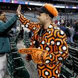 Tigers fan, Cheryl Gilliam admires Jamie Awad's of San Francisco outfit as the San Francisco Giants prepare to take on the Detroit Tigers in game four of the World Series on Sunday Oct. 28, 2012  at Comerica Park in Detroit, Michigan.