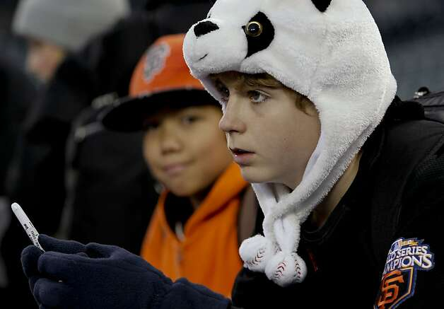 Giants fan, Jackson Allen, 12, from Texas who used to live in the Bay Area gathers around the Giants' dugout during batting practice as the San Francisco Giants prepare to take on the Detroit Tigers in game four of the World Series on Sunday Oct. 28, 2012  at Comerica Park in Detroit, Michigan. Photo: Michael Macor, The Chronicle