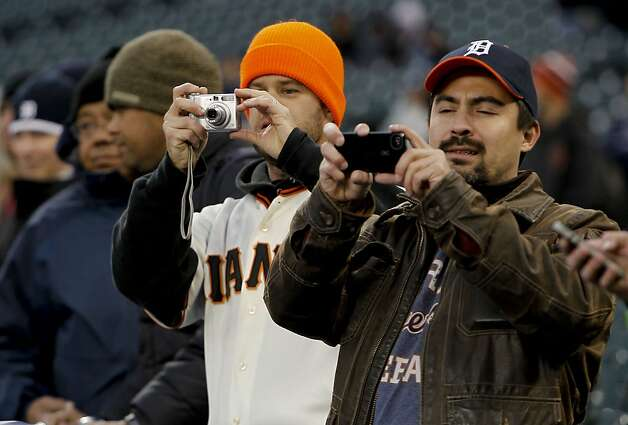 Brothers-in-law, Kevin Freese a Giants fan and Paul Fulton a Tigers fan watch as the Giants take batting practice as San Francisco prepares to take on the Detroit Tigers in game four of the World Series on Sunday Oct. 28, 2012  at Comerica Park in Detroit, Michigan. Photo: Michael Macor, The Chronicle