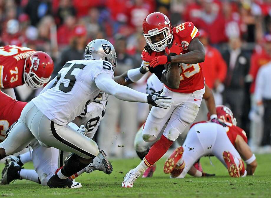 The Raiders' Rolando McClain defends Chiefs running back Jamaal Charles, who was held to 4 rushing yards on five attempts. Photo: Peter Aiken, Getty Images