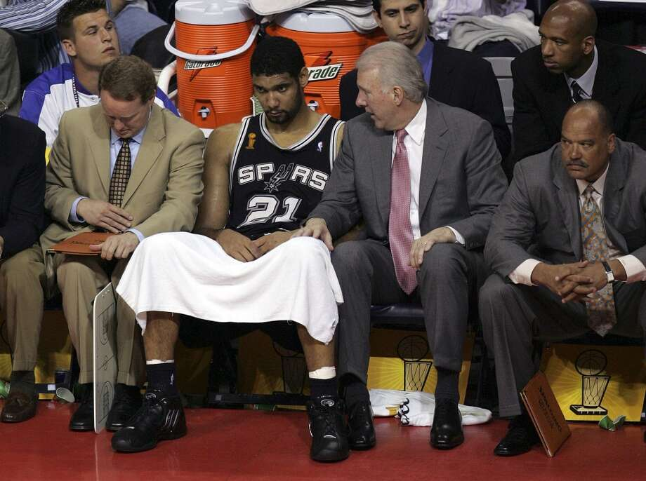Spurs' Tim Duncan (center) and coaches P.J. Carlissimo (from left), Mike Budenholzer, Gregg Popovich and Don Newman were at a loss for answers to their loss to the Pistons during the fourth quarter of game four of the NBA Finals at The Palace of Auburn Hills near Detroit, Michigan on Tuesday, June 14, 2005. Kin Man Hui/Express-News (SAN ANTONIO EXPRESS-NEWS)