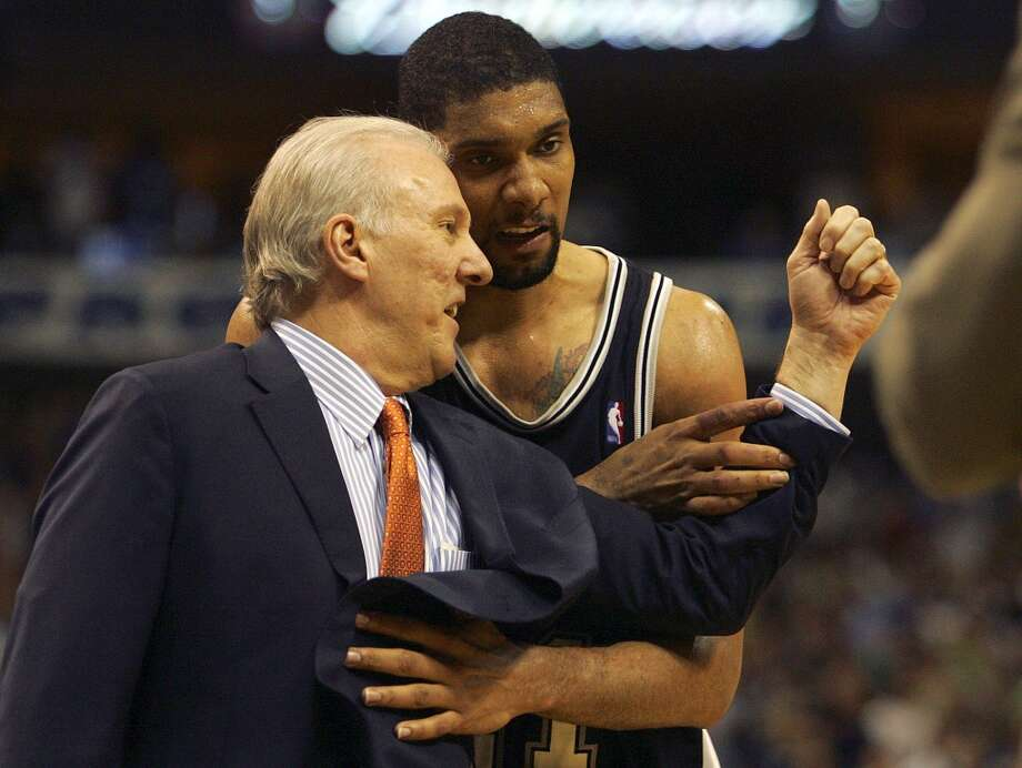 Coach Gregg Popovich tries to cheer up Tim Duncan after he missed a shot late during fourth quarter action at the American Airlines Center in Dallas, TX Friday May 19, 2006 game six NBA Western Conference semifinals. BAHRAM MARK SOBHANI/Express-News (SAN ANTONIO EXPRESS-NEWS)