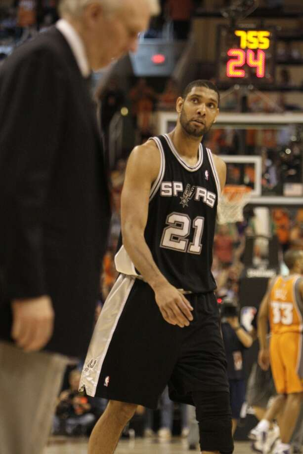 Spurs Tim Duncan looks at the clock as coach Gregg Popovich calls a time out during in the fourth quarter of game 2 of seven series in the Western Conference semi-finals at U.S. Airways Center, Wednesday, May 5, 2010. The Phoenix Suns won 110-102 to lead the series, 2-0. JERRY LARA/Express-News (San Antonio Express-News)