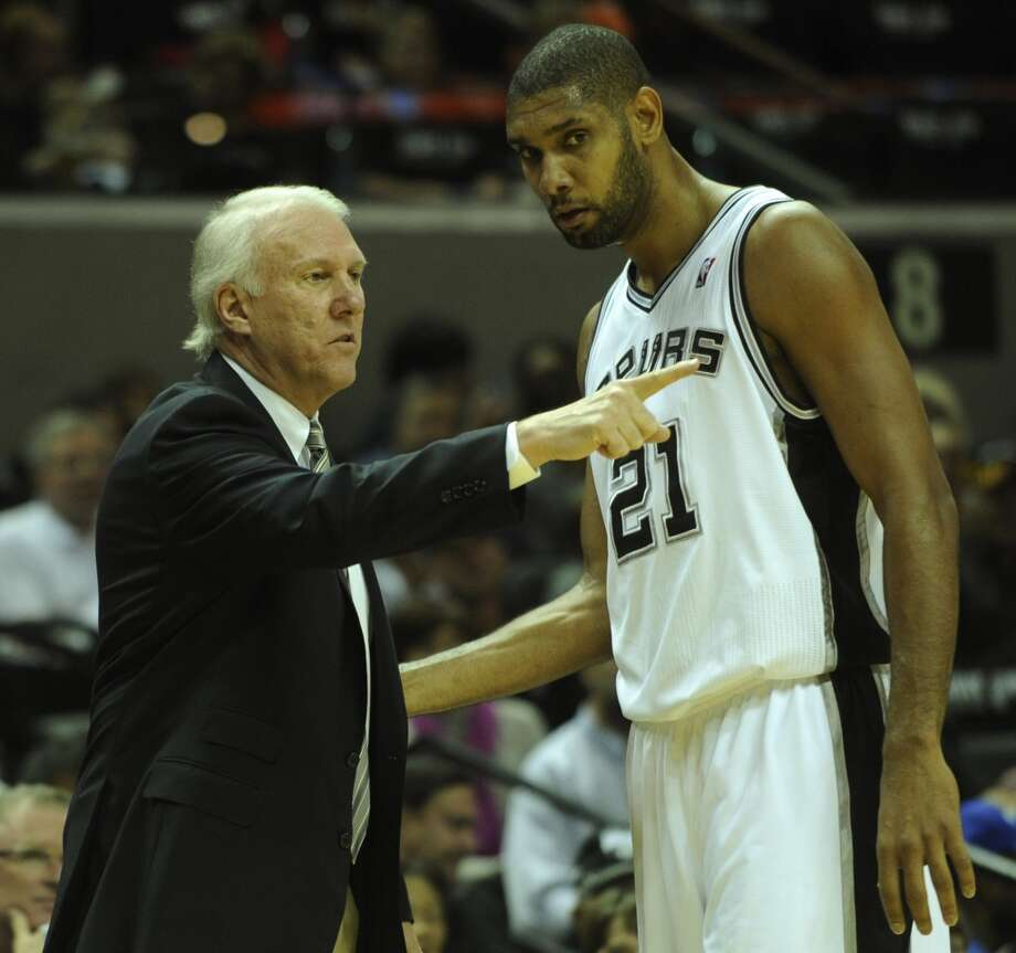 Spurs coach Gregg Popovich gives instructions to Tim Duncan during first-half NBA action against the New Orleans Hornets at the AT&T Center on Saturday, Oct. 30, 2010. BILLY CALZADA/Express-News (SAN ANTONIO EXPRESS-NEWS)