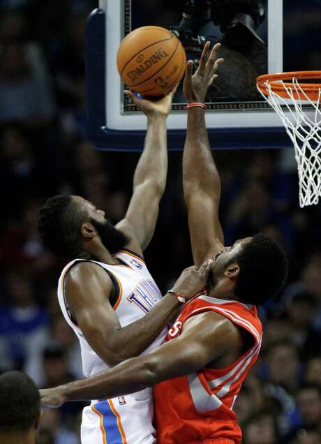 Forward Patrick Patterson, right, believes that the Rockets' playoff chances have improved playing with rather than against James Harden. Photo: Sue Ogrocki, STF / AP