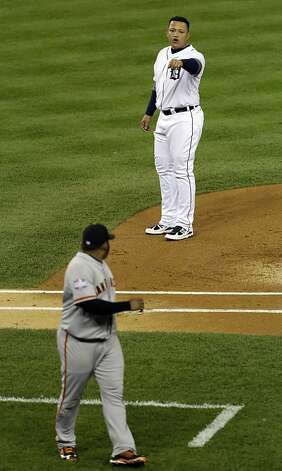 Detroit Tigers' Miguel Cabrera talks to San Francisco Giants' Pablo Sandoval after being stranded on base during the first inning of Game 4 of baseball's World Series Sunday, Oct. 28, 2012, in Detroit. (AP Photo/Paul Sancya ) Photo: Paul Sancya, Associated Press