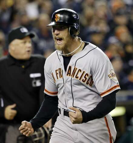 San Francisco Giants' Hunter Pence reacts as he runs home to score a run during the second inning of Game 4 of baseball's World Series against the Detroit Tigers Sunday, Oct. 28, 2012, in Detroit. (AP Photo/David J. Phillip) Photo: David J. Phillip, Associated Press