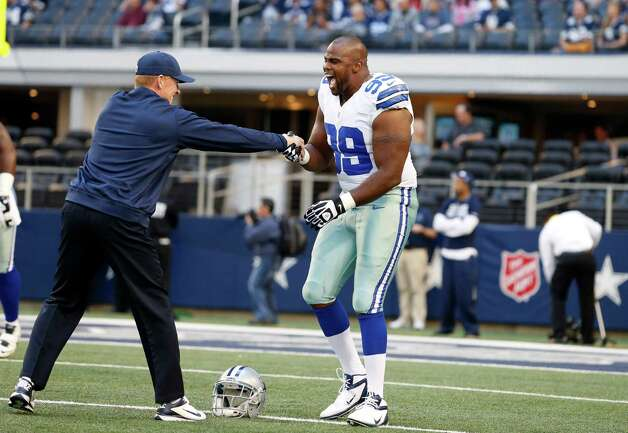 Dallas Cowboys head coach Jason Garrett shakes hands with defensive tackle Kenyon Coleman (99) before an NFL football game against the New York Giants Sunday, Oct. 28, 2012 in Arlington, Texas. (AP Photo/Sharon Ellman) Photo: Sharon Ellman, Associated Press / FR170032 AP