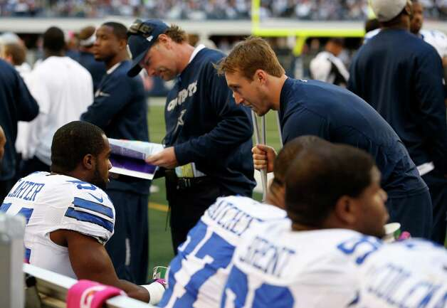 Dallas Cowboys linebacker Bruce Carter (54) listens to injured inside linebacker Sean Lee during the first half of an NFL football game against the New York Giants Sunday, Oct. 28, 2012 in Arlington, Texas. (AP Photo/Sharon Ellman) Photo: Sharon Ellman, Associated Press / FR170032 AP